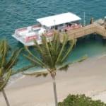 Scuba tour boat at a pier.