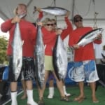 Fishers holding their catches.
